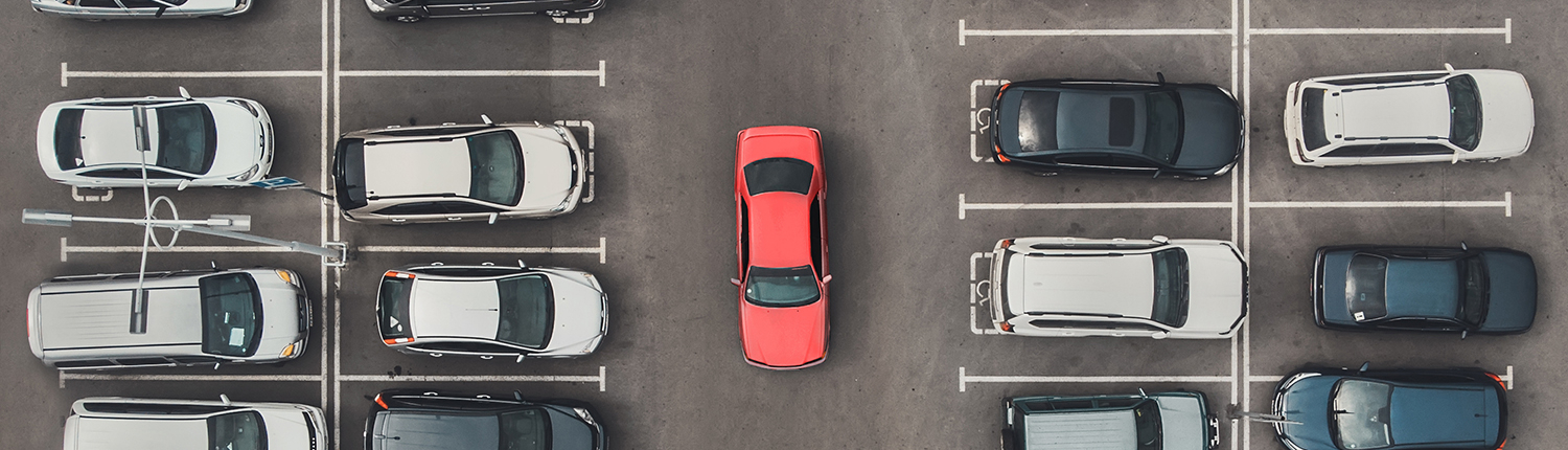 Top view of the crowded Parking lot with quadcopter or drone.